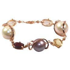 Fantasy bracelet in 18kt rose gold with gems and freshwater cultured pearls