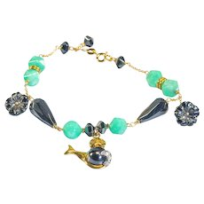 18Kt gold bracelet with seal and flower pendants made of green chrysoprase, black hematite and diamonds