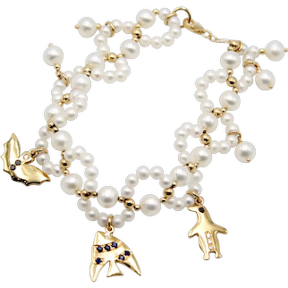 Fancy bracelet with freshwater cultured pearls, 18kt gold spheres and animal pendants with diamonds and sapphires
