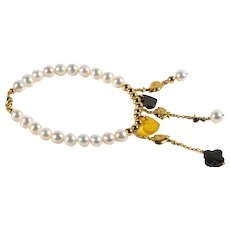18kt Yellow gold bracelet with whale pendants, freshwater cultured pearls, onyx and chalcedony