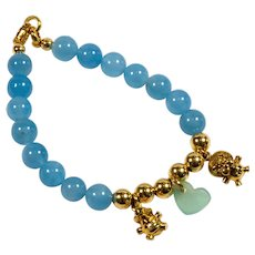 Fancy bracelet in 18kt yellow gold with aquamarine spheres and lion and crocodile pendants