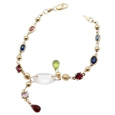 Bracelet in 18kt yellow gold with gold spheres and precious stones
