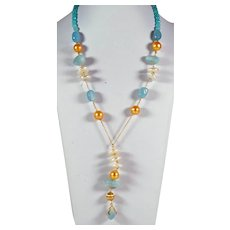 18kt Yellow gold necklace with aquamarine, baroque freshwater cultured pearls and colored-treated gold pearls