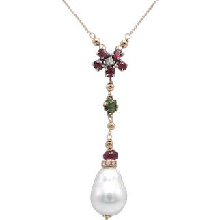 18Kt rose gold necklace with rubies, tourmaline, diamonds and baroque saltwater pearl