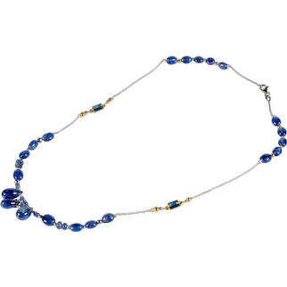 White and yellow 18kt gold necklace with sapphires and iolites