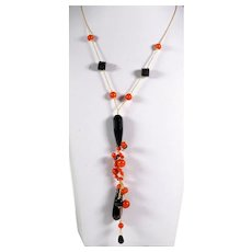 Fancy necklace in 18kt yellow gold with red coral and onyx
