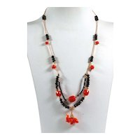 Necklace in 18kt rose gold with coral and black spinel with elephant pendant