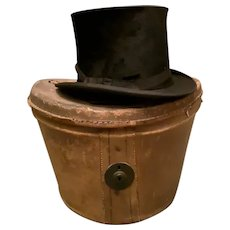 Antique black silk top hat, Antique hat box