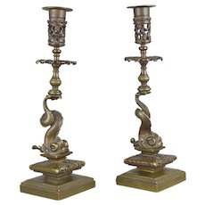 Pair of 19th century Renaissance style patinated bronze candlesticks in the shape of dolphins