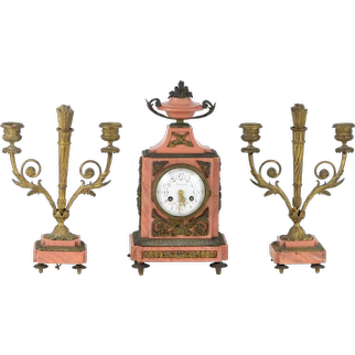 Marble and bronze mantel clock with a pair of candelabras signed Ardavani Paris XIXth century