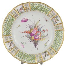18th century Nymphenburg porcelain plate. Polychrome floral and birds decoration.