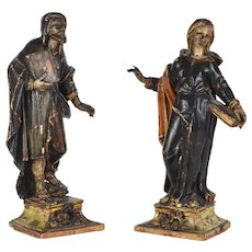 Pair Of 17th Century Carved And Polychromed Wooden Sculptures Of Saints Holding A Book