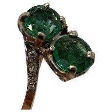Stunning vintage 14kt gold emerald, diamond bypass ring