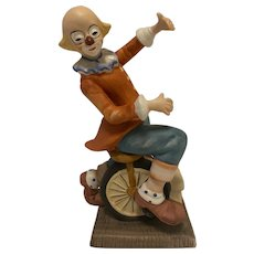 """Vintage Porcelain Clown Riding a Unicycle, 7"""" Tall"""