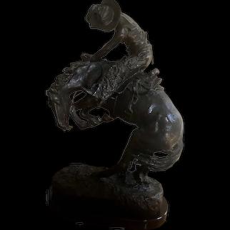 "After Frederic Remington, Cast Bronze Sculpture of A Cowboy on Horse, ""Rattlesnake"""