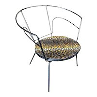 Pair of modernist Mid Century era iron wire armchair with leopard print seat.Circa 1950