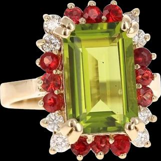 6.67 Carat Emerald Cut Peridot Sapphire and Diamond 14 Karat Yellow Gold Ring