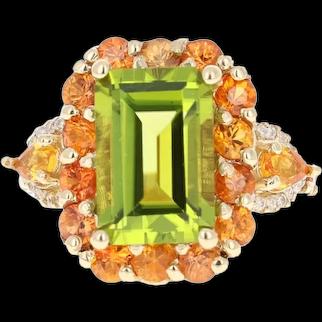 7.30 Carat Emerald Cut Peridot Sapphire and Diamond 14 Karat Yellow Gold Ring