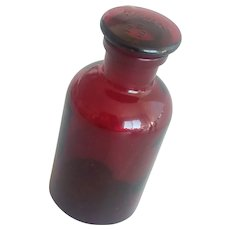 Vintage drugstore red glass apothecary bottle
