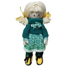 Handmade doll with a backpack as a gift for your beloved