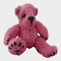 Collectible miniature pink bear, knitted by hand