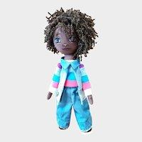 Dark-skinned designer doll made of fabric