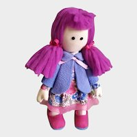 Cute handmade doll for the interior of a children's room