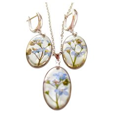 Jewelry set - earrings and necklace made of epoxy resin with forget-me-nots. A set of handmade jewelry with flowers.