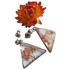 Pink flower and epoxy triangular stud earrings. Botanical natural jewelry.