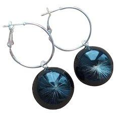 Hoop earrings made of dandelion down and black resin.