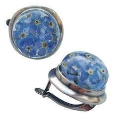 Round earrings with blue forget-me-not. Lightweight and durable earrings made of jewelry epoxy resin