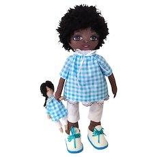Handmade dark-skinned doll. Designer doll made of fabric
