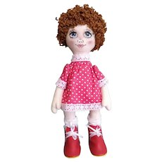 Author's doll with red hair from handmade fabric. Doll as a gift