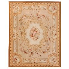 French Aubusson style rug,  20th Century with beige field and floral motifs  310cm x 235cm