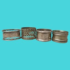 Antique silver plated napkin rings, set of 4