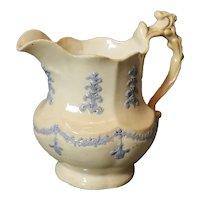 Antique French porcelain jug, design of swags and fleur-de-lis