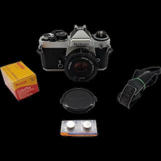 Pristine shape Nikon FE film camera with Nikon 50mm 1:1.8 series E Lens