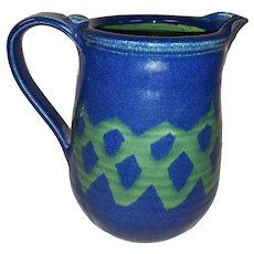 Vintage Heavy Hand Made Pottery Pitcher with Heavy Glazing Inside and Out - Hand Painted Navy Blue with Green Design