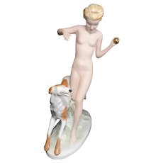 Royal Dux figurine a nude girl holding a ball with a dog hound running