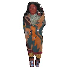SKOOKUM Woman with Papoose: Mary McAboy Glass Bead Necklace; Human Hair Wig with Evidence of Foot Label