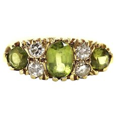 18k Large Peridot and Diamond Ring. Made in UK 1976. 6.4grams with 0.40ctw in diamonds