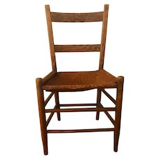 Mid 1800's primitive ladder back chair w/ leather seat