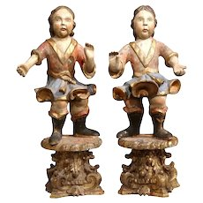 Pair of 18th Century Italian Carved Polychrome Sculptures on Wooden Gilt Stands