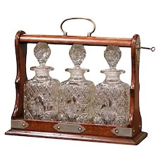 Early 20th Century English Oak and Brass Tantalus with Cut-Glass Decanters