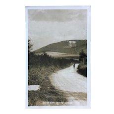 Westbury White horse postcard 1915. Cut into chalk on an English hillside