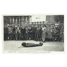 London escapologist performing in Charing Cross Road. Original old postcard from c.1950.