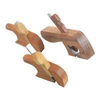 Thee miniature tailed wood planes
