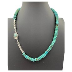 Necklace of American turquoise rondels, sterling bench beads, and a turquoise and sterling clasp
