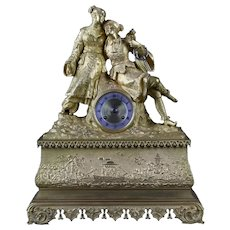 French clock from 1800 Parisian in gilt bronze depicting an oriental couple