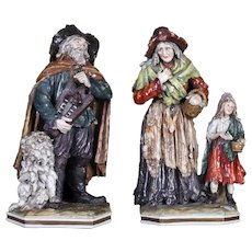 Pair of Italian porcelain sculptures with N Capodimonte mark